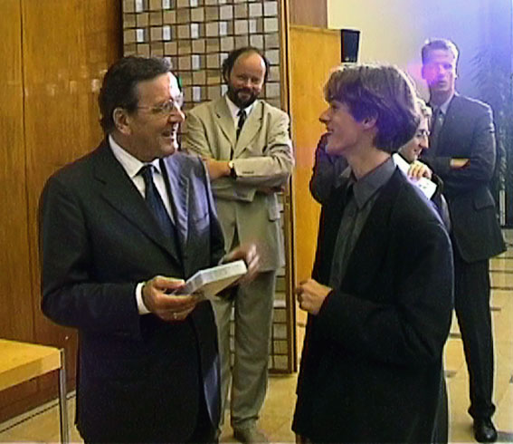 Former German Chancellor Gerhard Schröder and Sebastian Voltmer