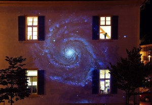 large projection onto a house facade